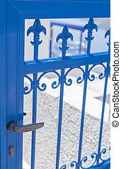 Blue gate - Image of a lovely ornate blue gate. Santorini,...