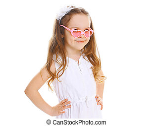 Fashion kid Beautiful little girl in the pink sunglasses on...