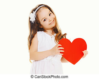 Happy little girl with big red paper heart on a white...