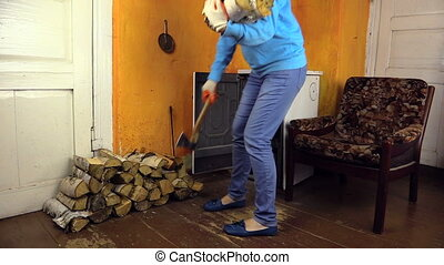 woman axe and firewood - Cute woman carry axe and armful of...