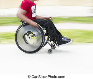 man in wheelchair - Young man in wheelchair taking part in...