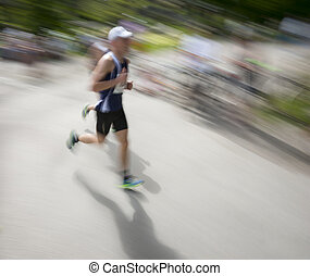 running man - Man in blurred motion in running competition