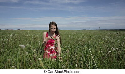 teen girl making a wreath on the meadow