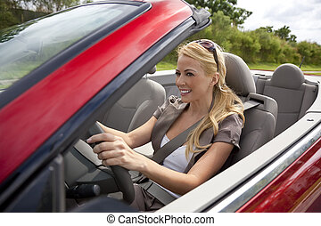 Beautiful Young Woman Driving Convertible Car - A beautiful...