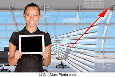 Businesslady in businesscenter - Businesslady holding tablet...