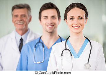 Medicine - Young female doctor with colleagues at doctor's...