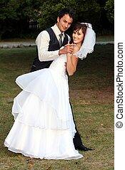 Dancing Wedding Couple - Beautiful wedding couple danving on...