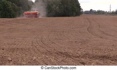 field soil fertilization - Soil earth and tractor spread...