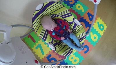 cute baby in swing - cute infant baby boy or girl sway in...