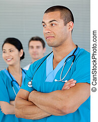 Ethnic doctor with his colleagues in the background