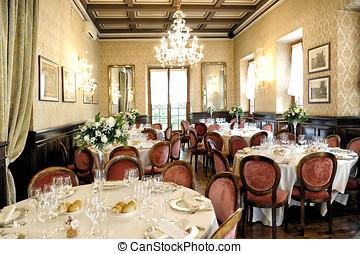 Elegant wedding venue interior with tables