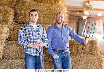 Two farm workers in hayloft - Portrait two farm workers...