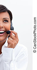 Smiling businesswoman with headset on