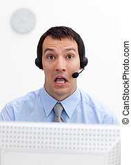 Laughing businessman with headset on