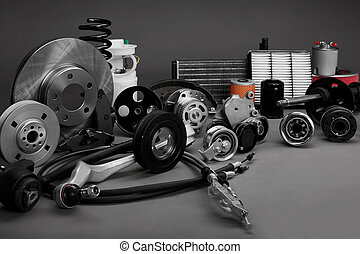car parts - New car parts on a gray background closeup. Shop...