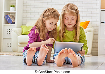 digital tablet - happy children holding digital tablet