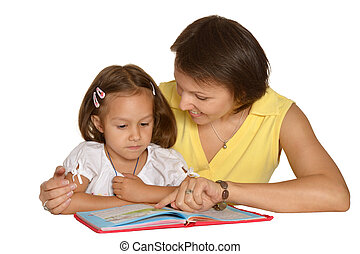 Mother doing homework with daughter - Mother doing homework...