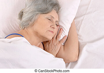 older woman sleeping in the bedroom - Beautiful older woman...