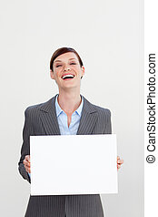 Laughing businesswoman holding white card isolated on white...