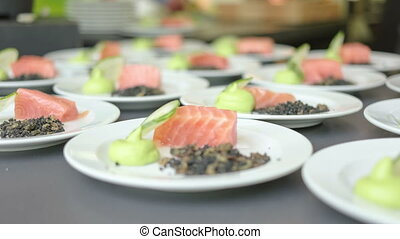 Food festival - A chef finishing up plating of salmon