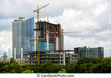 Construction Cranes - Construction of new modern building,...