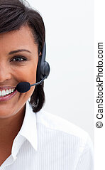 Ethnic customer service agent with headset on against white...