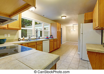 Authentic kitchen with tile floor.