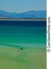 Paddle Surfing Byron Bay - Paddle Surfer on Beach in Byron...