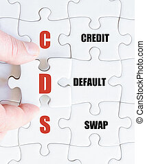 Last puzzle piece with Business Acronym CDS - Hand of a...