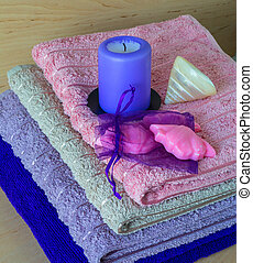 Towels, soap, candle