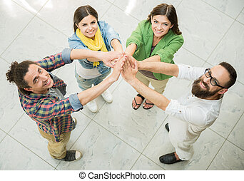Designer team - Creative group of designers putting hands...