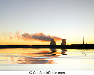 Nuclear station on a decline on the bank of a reservoir