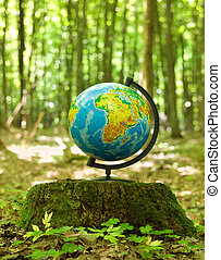 The globe on hemp in summer wood. Round-the-world travel
