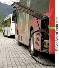 Charging electric buses - Charging plugin electric buses...