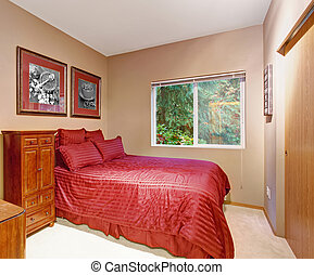 Stylish bedroom with carpet, and one window.
