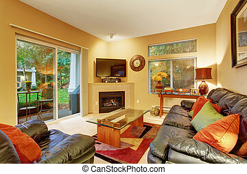 Cozy meduim sized living room with carpet and sliding glass door.