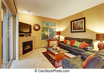 Cozy meduim sized living room with carpet and sliding door.