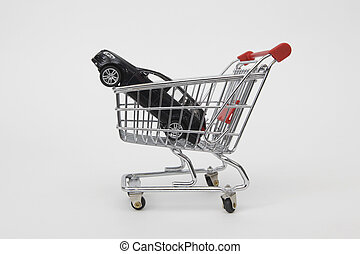 Shopping cart with car - black car inside a shopping cart on...