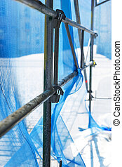 debris netting - Close up of debris netting on scaffolding,...