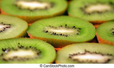 Close view of kiwi fruit slices - Slider view of kiwi fruit...