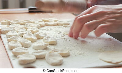 the process of cooking dumplings - the process of forming...