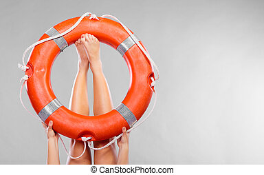 Life buoy ring on female legs - Accident prevention and...