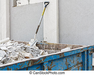Full construction waste debris container, garbage bricks and...