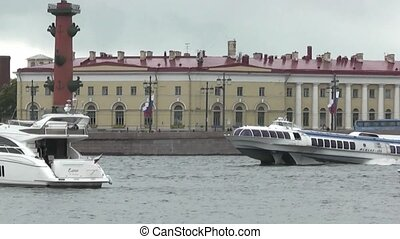 Yacht and boat excursion float on the waters of the Neva