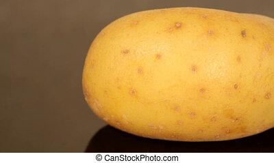 A ripe potato on a black pan closeu - Closeup of a ripe...