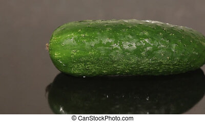 A cucumber on a black pan closeup - Closeup of a fresh...