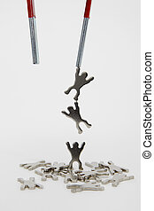 Teambuilding - Magnet Lifting Metal Figures on white...