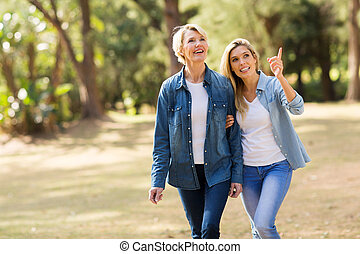 senior mother with daughter relaxing outdoors