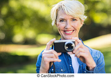 middle aged woman with her camera - pretty middle aged woman...