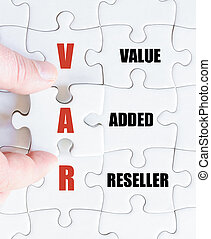 Last puzzle piece with Business Acronym VAR - Hand of a...